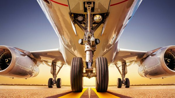 bigstock-Modern-Airliner-On-A-Runway-Ag-389358487 (1)